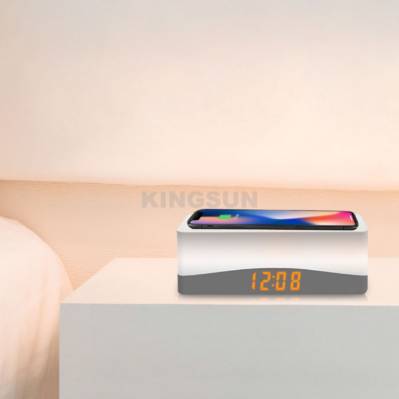 Desktop wireless phone charger with nightlight and alarm clock